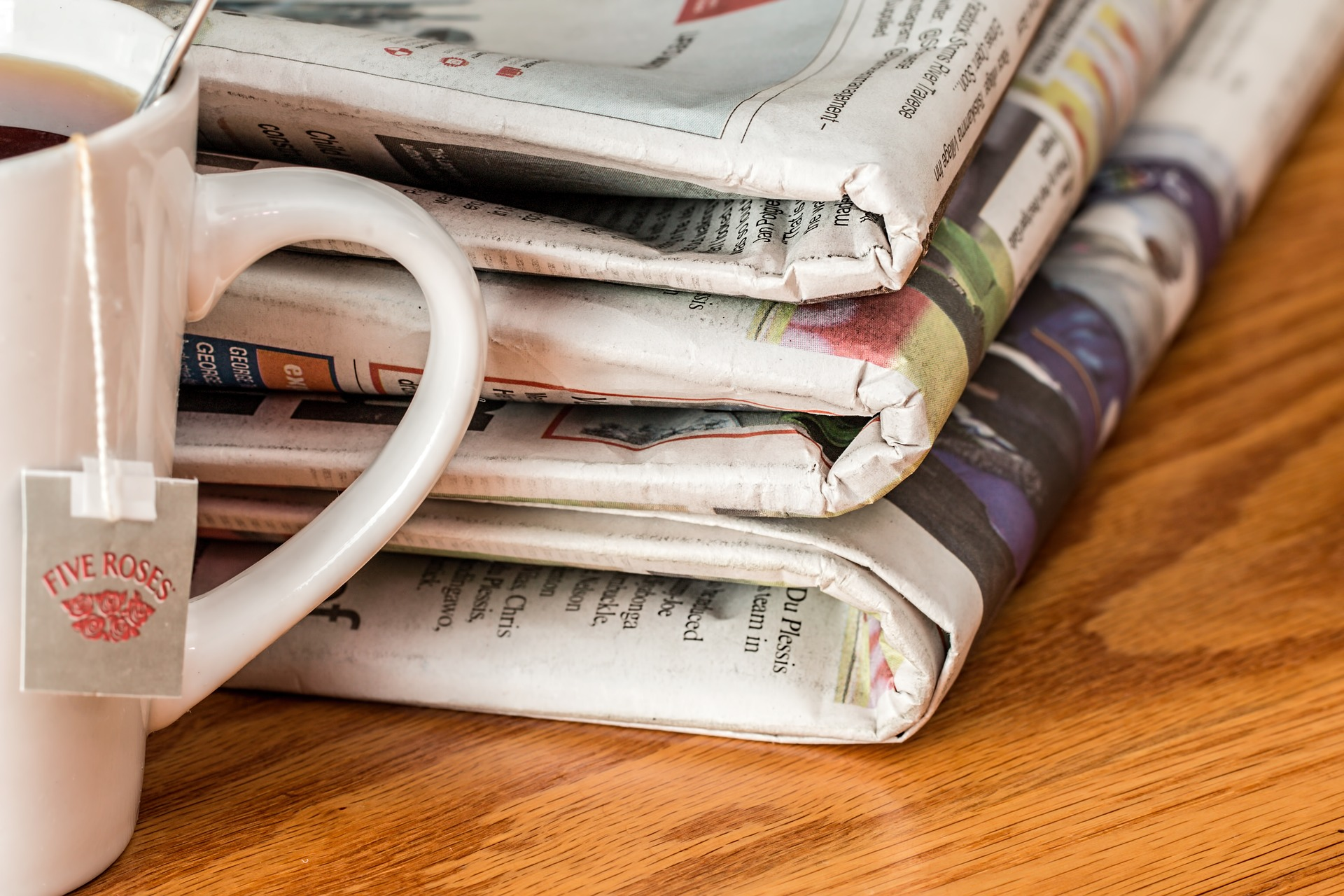 newspapers with tea